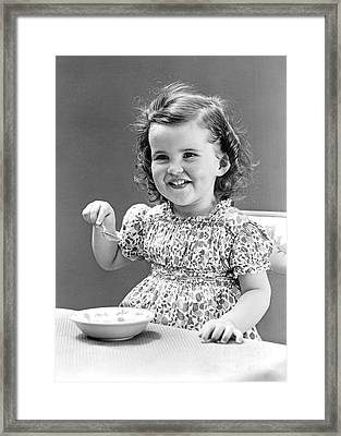 Girl Eating Ice Cream, C.1940-30s Framed Print by H. Armstrong Roberts/ClassicStock