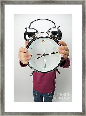 Girl Holding Alarm Clock Over Face Framed Print by Sami Sarkis