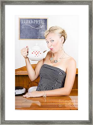 Girl In Cafe Serving Hot Coffee With Heart Teapot Framed Print by Jorgo Photography - Wall Art Gallery