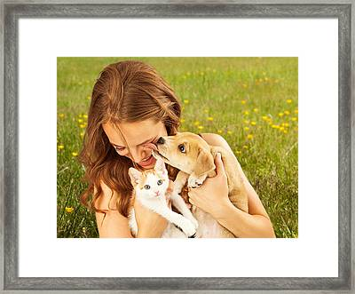 Girl In Field With Kitten And Affectionate Puppy Framed Print by Susan Schmitz
