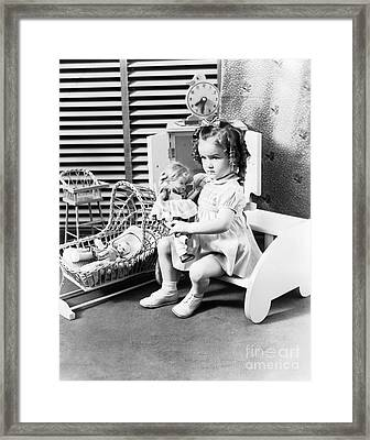 Girl Playing With Dolls, C.1930-40s Framed Print by H. Armstrong Roberts/ClassicStock