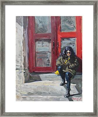 Girl Sitting At Red Doorstep Framed Print by Ylli Haruni