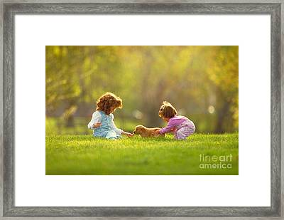 Girls And Puppy At Play In The Park Framed Print by James Wvinner