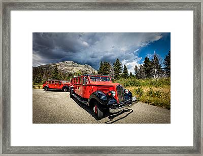 Glacier National Park Antique Bus Framed Print by Andres Leon