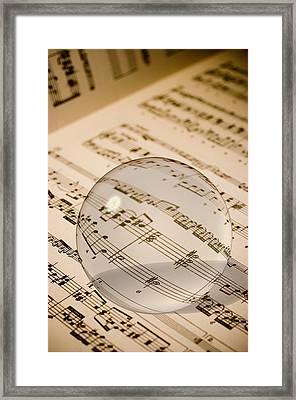 Glass Ball On Sheet Music Framed Print by Utah Images