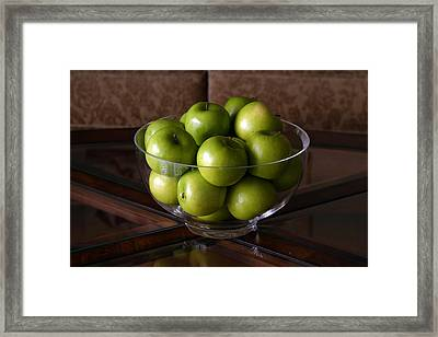 Glass Bowl Of Green Apples  Framed Print by Michael Ledray
