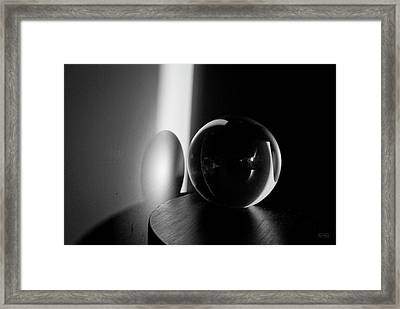 Glass Sphere In Light And Shadow Framed Print by David Gordon