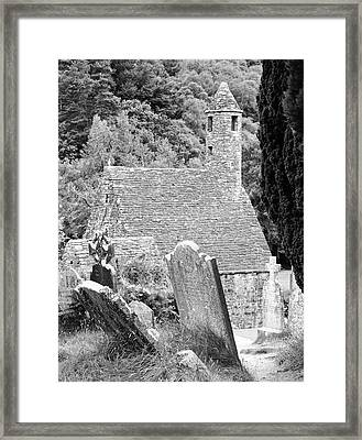 Glendalough Ireland St Kevins Church Behind Headstones Wicklow Mountains Black And White Framed Print by Shawn O'Brien