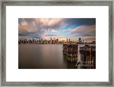 Gotham City Afternoon Framed Print by Abe Pacana