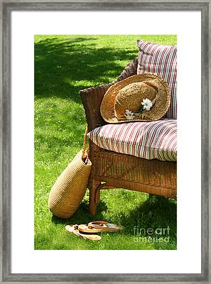 Grass Lawn With A Wicker Chair  Framed Print by Sandra Cunningham