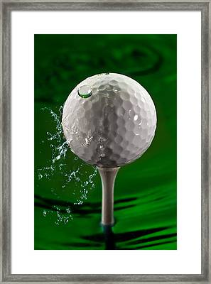 Green Golf Ball Splash Framed Print by Steve Gadomski