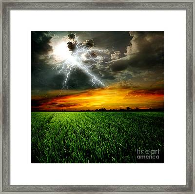 Green Grass Against A Stormy Sky Framed Print by Unknow