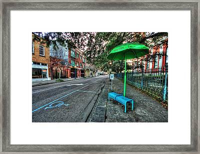 Green Umbrella Bus Stop Framed Print by Michael Thomas