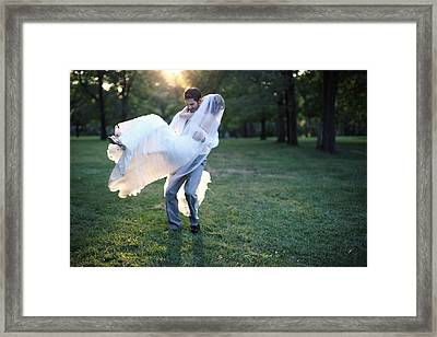Groom Carrying Bride - F Framed Print by Gillham Studios