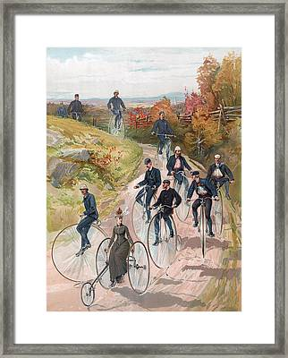 Group Riding Penny Farthing Bicycles Framed Print by American School