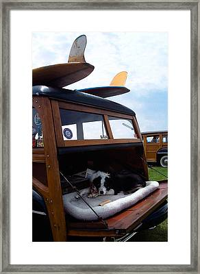 Guarding The Wood Framed Print by Ron Regalado