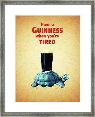 Guinness When You're Tired Framed Print by Mark Rogan