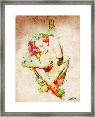 Guitar Lovers Embrace Framed Print by Nikki Smith