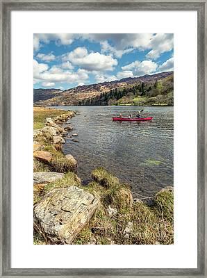 Gwynant Lake Canoeing Framed Print by Adrian Evans