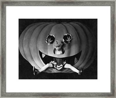 Halloween Girl And Her Pumpkin Framed Print by Underwood Archives