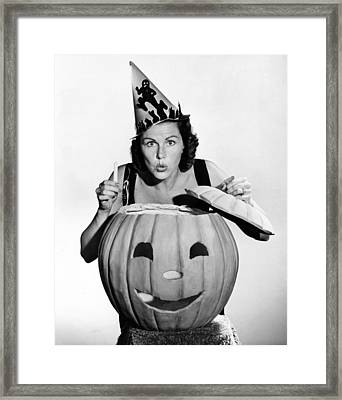 Halloween Woman And Pumpkin Framed Print by Underwood Archives