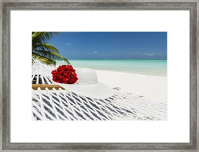 Hammock With Flowers And Hat On A Tropical Beach Framed Print by Pete Atkinson