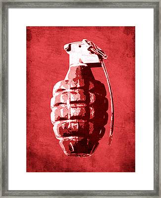Hand Grenade On Red Framed Print by Michael Tompsett