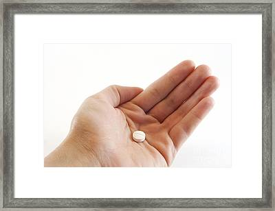 Hand Holding Medicinal Tablet Framed Print by Blink Images
