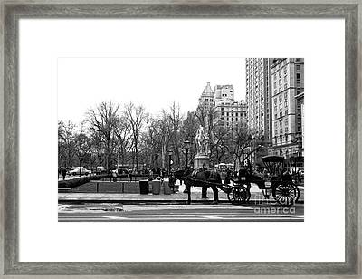 Handsome Cab At The Grand Army Plaza Framed Print by John Rizzuto