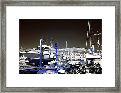 Hanging Boats Framed Print by John Rizzuto