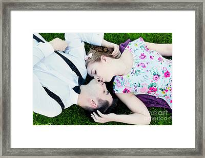 Happy Couple In Love Kissing While Lying On Summer Grass Framed Print by Michal Bednarek