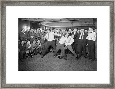 Harry Houdini Cannot Escape The Hold Framed Print by Everett