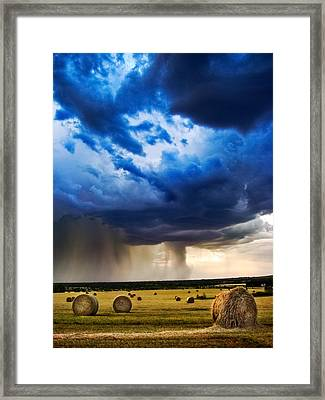 Hay In The Storm Framed Print by Eric Benjamin