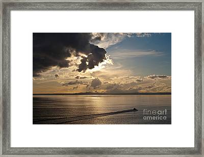 Heading Out On Sunset Patrol Framed Print by Mike Reid