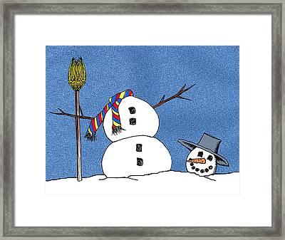 Headless Snowman Framed Print by Nancy Mueller
