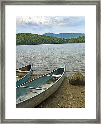 Heart Lake Canoes In Adirondack Park New York Framed Print by Brendan Reals