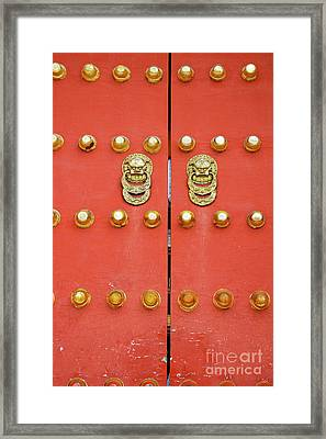 Heavy Ornate Door Knockers On A Gate Framed Print by Sami Sarkis