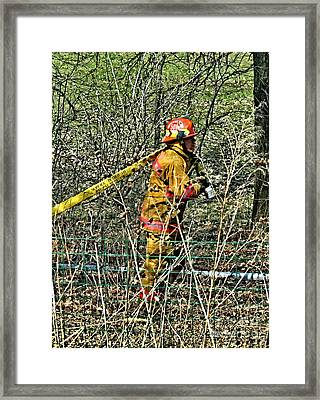 Hose Advance Framed Print by Tommy Anderson