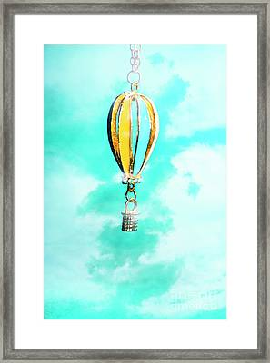 Hot Air Balloon Pendant Over Cloudy Background Framed Print by Jorgo Photography - Wall Art Gallery