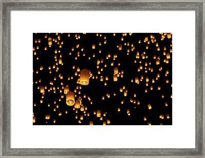 Hot Air Lanterns In Sky Framed Print by Daniel Osterkamp