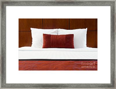 Hotel Room Bed And Pillows Framed Print by Paul Velgos