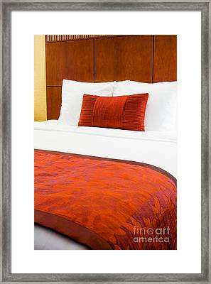 Hotel Room Bed  Framed Print by Paul Velgos