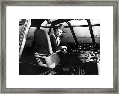 Howard Hughes, At The Controls Framed Print by Everett
