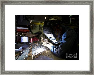 Hull Maintenance Technician Strikes Framed Print by Stocktrek Images