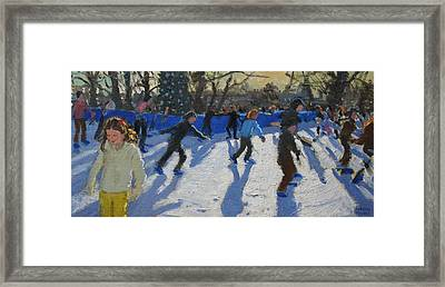 Ice Skaters At Christmas Fayre In Hyde Park  London Framed Print by Andrew Macara