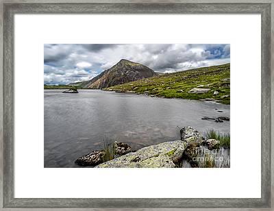 Idwal Lake Rocks Framed Print by Adrian Evans