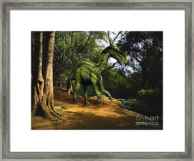 Iguanodon In The Jungle Framed Print by Frank Wilson