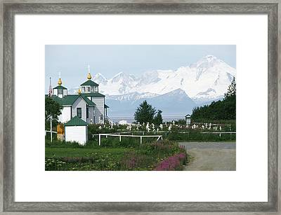 IIamna Volcano Looms Above A Russian Framed Print by Rich Reid