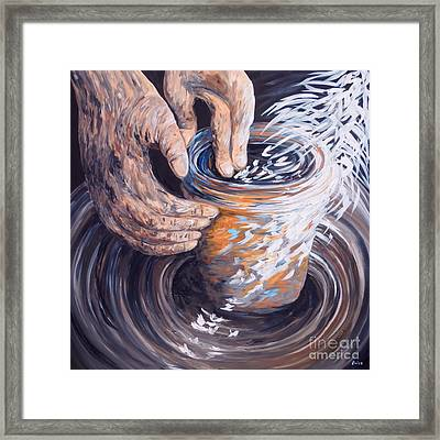 In The Potter's Hands Framed Print by Eloise Schneider