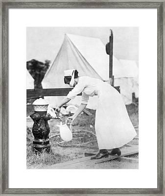 Influenza Outbreak Nurse Framed Print by Underwood Archives